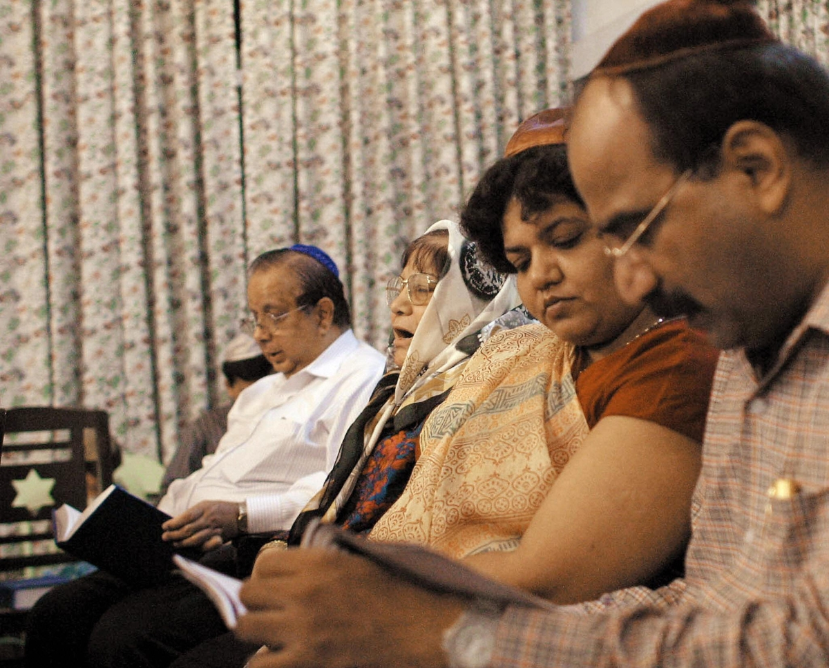 Indian Jews singing hymns at the Judah Hyam Hall Synagogue in New Delhi on September 4, 2003. (Findlay Kember/AFP/Getty Images)