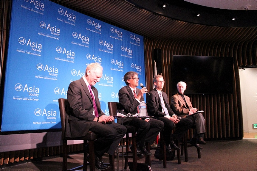 "Panelists for ""Policy and Regulation"" chuckle during the first session. (Asia Society)"