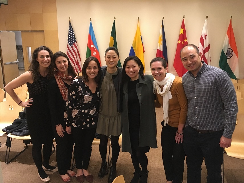 Mina Kim (center), PM Anchor and KQED Forum Friday host, graciously agrees to take a photo with some members of the ASNC Young Professionals Group. (Asia Society)