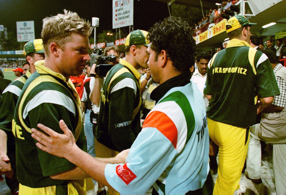 Tendulkar (C) shakes hands with Australian cricketers after the Indian victory against Australia in a final match in Sharjah on April 24, 1998. (Rabih Moghrabi/AFP/Getty Images)