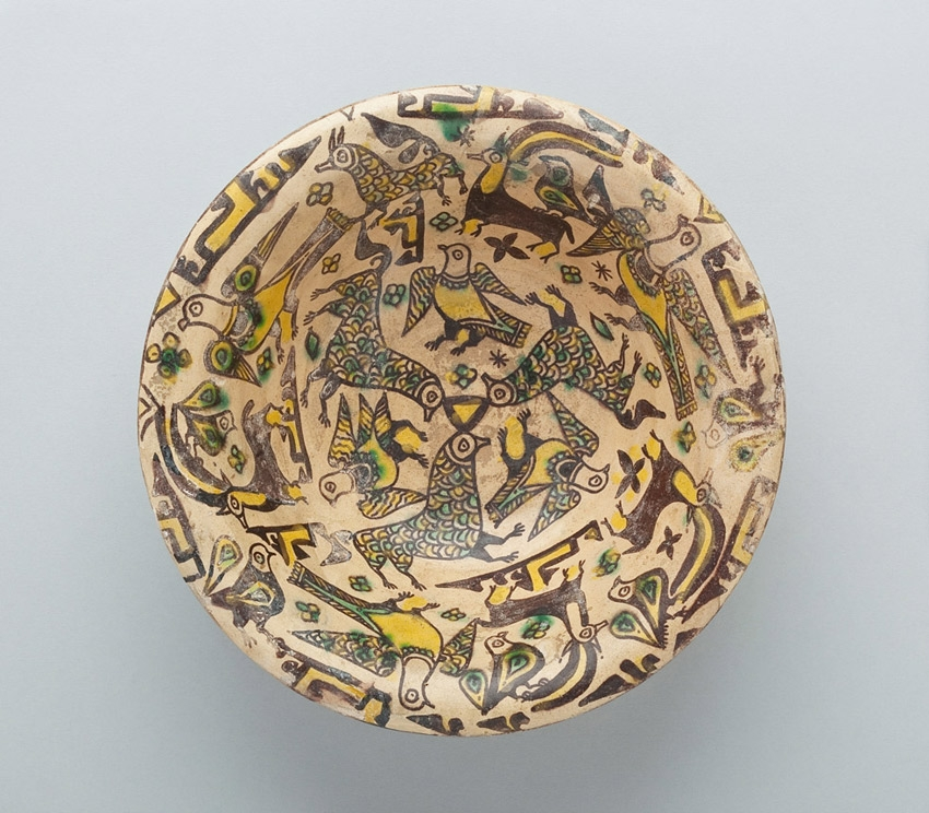 Bowl with Birds, Ibex, Floral, Calligraphic and Geometric Motifs, Nishapur, Iran, 9th-10th century, Abbasid Period (750-1258), Buff clay body with dark brown slip and yellow, green and clear glazes, Purchase 1970 John O'Neill Fund, Collection of the Newark Museum 70.16