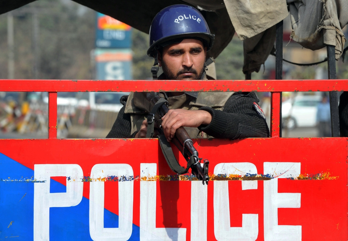 A Pakistani policeman stands guard at a security check point in Lahore, February 2012. (Arif Ali/AFPGetty Images)