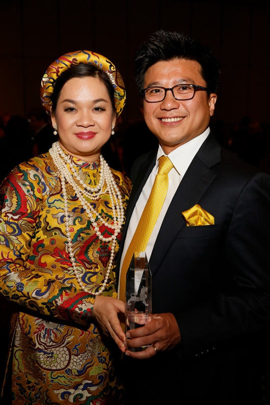 From left, Phuong Nguyen and 2015 Sports Visionary award winner Henry Nguyen, Managing Partner, IDG Ventures Vietnam and Managing Partner, Los Angeles Football Club pose during the 2015 Asia Society Southern California Annual Gala on Thursday, June 20, 2015, in Century City, Calif. (Photo by Ryan Miller/Capture Imaging)