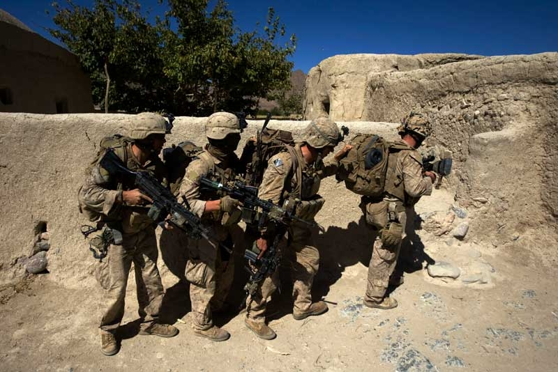 US Marines breach into a house in the Bhuji Bhast Pass in Farah Province, Afghanistan on October 9, 2009. The pass is a Taliban stronghold. (David Furst/AFP/Getty Images)