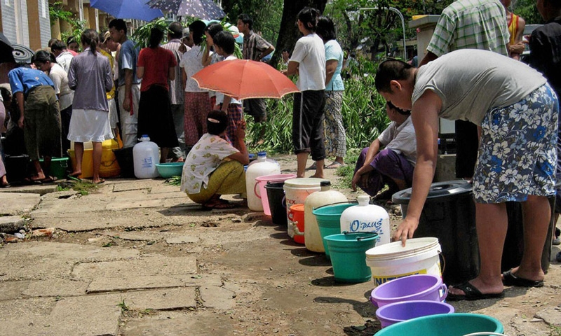 Residents queue to get drinking water in Yangon on May 5, 2008. (Hla Hla Htay/AFP/Getty Images)