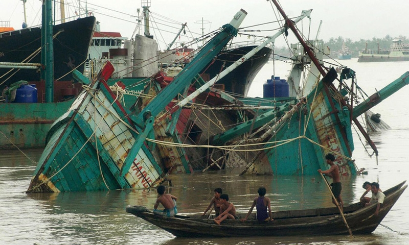 Destroyed fisherman boats lay in the port of Yangon after cyclone Nargis on May 4, 2008. (Khin Maung Win/AFP/Getty Images)