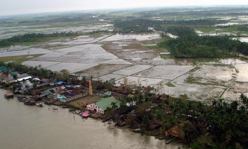 This aerial view shows a devastated factory, with many roofs missing, in a village in the Irrawaddy Delta region on May 5, 2008. (STR/AFP/Getty Images)