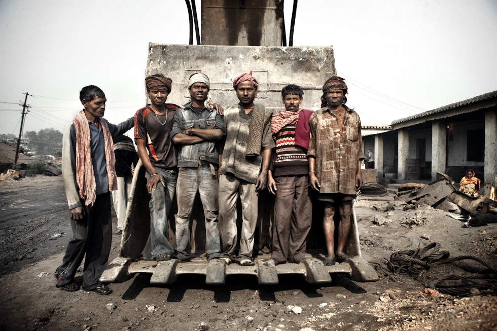 Miners pose for a photo in a mine near Dhanbad. (Erik Messori)