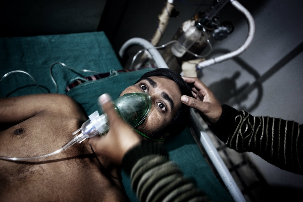 A miner with serious respiratory problems is treated with oxygen. (Erik Messori)