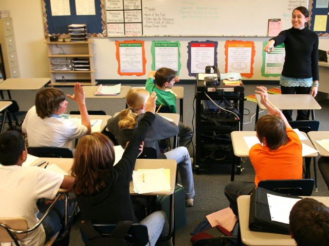 Students in a classroom. (kurtly/istockphoto)