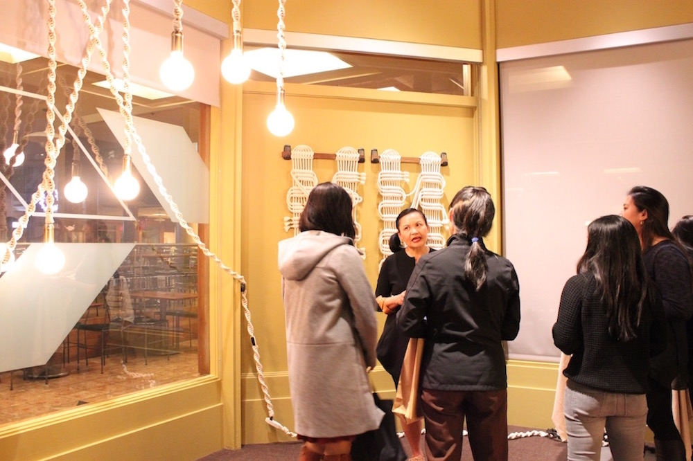 Guests speak with artist Windy Chien (Ranna Iglesias Asia Society).