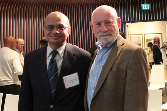 Chellaney and Schwartz pose for a photo. (Asia Society)