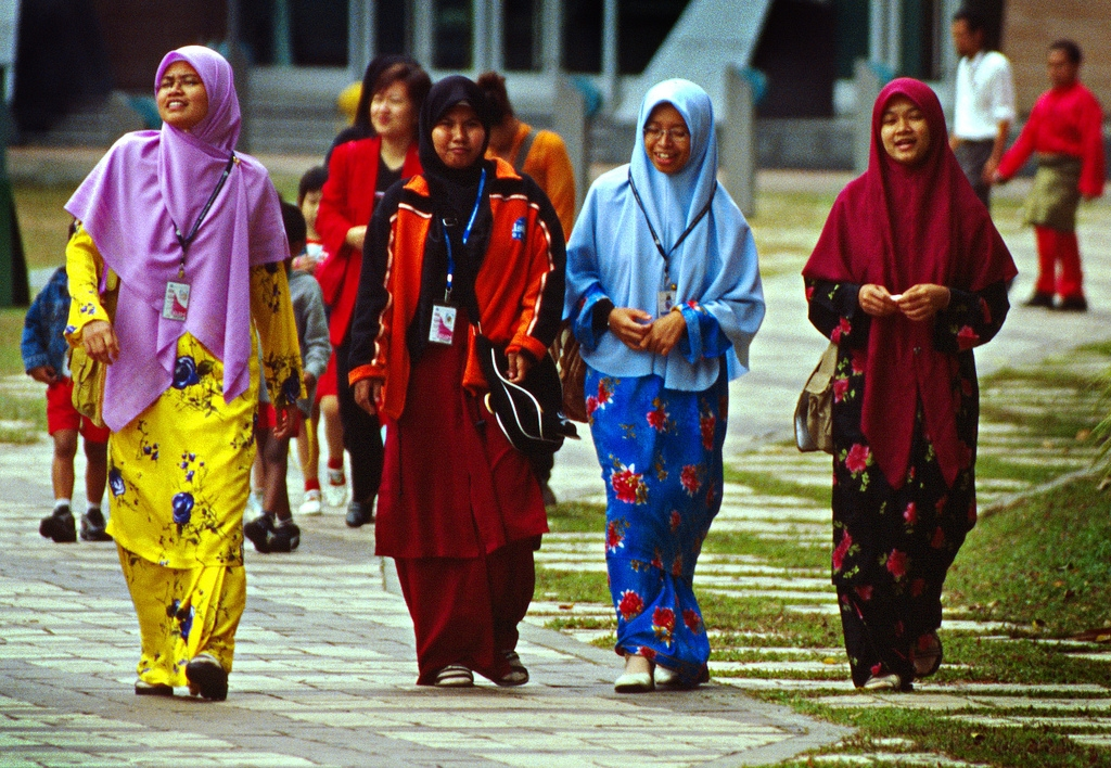 Colorful Islamic Malay women, stolling the park between the Kuala Lumpur Convention Center and the Petronas Towers. (Vin Crosbie/Flickr)