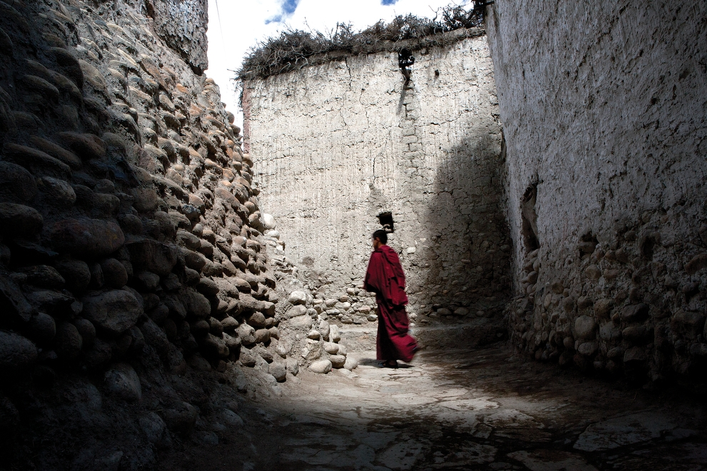 A monk walks through the alleyways of Lo Manthang. (Taylor Weidman)