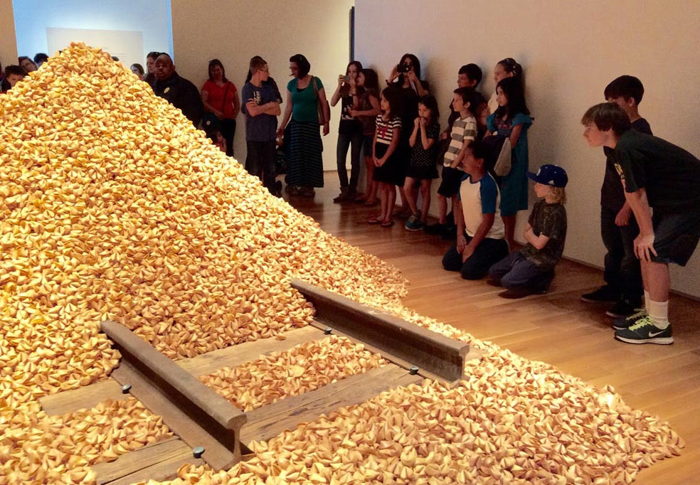 "Students taking a close look at Hung Liu's ""Old Gold Mountain"" featured in the exhibition 'The Other Side: Chinese and Mexican Immigration to America.' (Sarah Hua)"