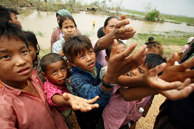 YANGON, MYANMAR - Burmese children beg for food as aid begins to arrive a week after the cyclone, on May 13, 2008. (Getty Images)
