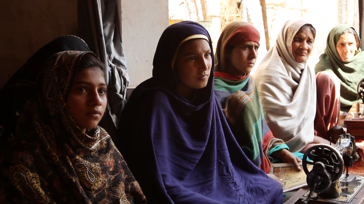 Participants in a women's rights workshop listen to a song by Rani Shameem Akhtar in Malival, Punjab. (Andreas Burgess)