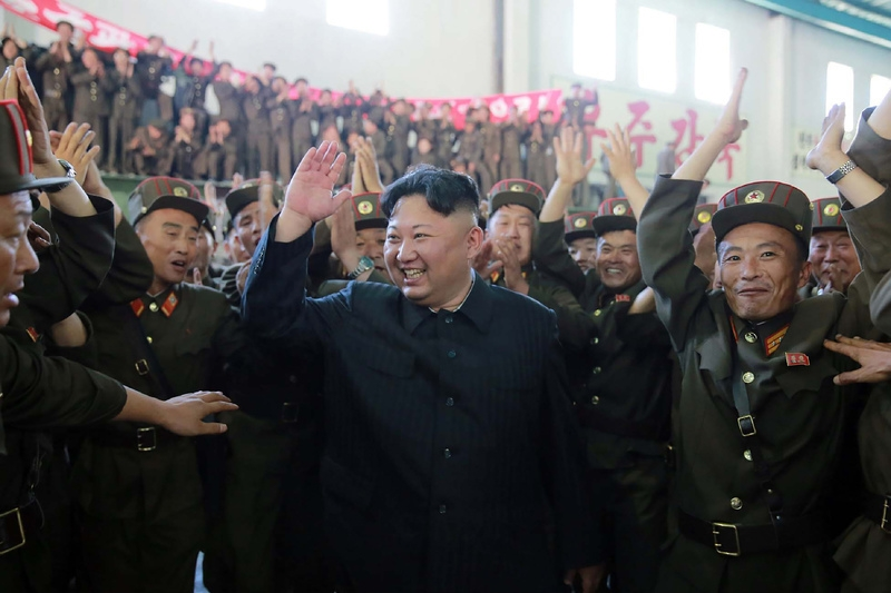 This picture taken on July 4, 2017 and released from North Korea's official Korean Central News Agency on July 5, 2017 shows North Korean leader Kim Jong-Un celebrating the successful test-fire of the intercontinental ballistic missile Hwasong-14 at an undisclosed location. (STR/AFP/Getty Images)