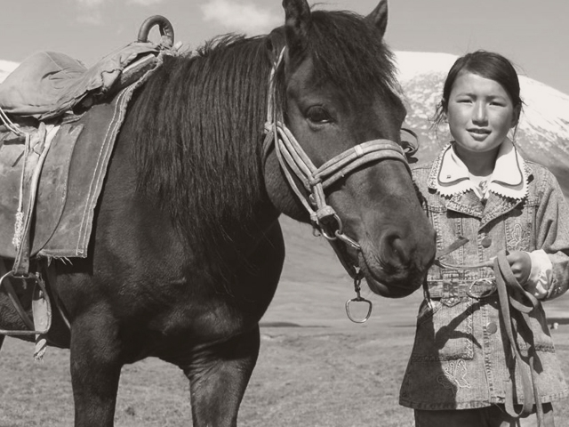 Woman standing with horse. (kitseeborg/flickr)