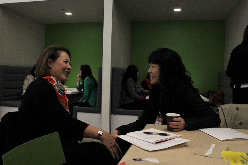 Kohara and Anna Mok, Partner at Deloitte, take the opportunity to catch up over coffee (Stesha Marcon).