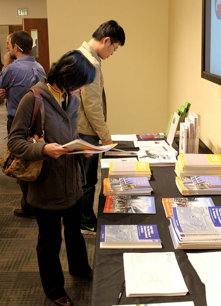 Attendees at the event browsing Asia Society materials (Asia Society)