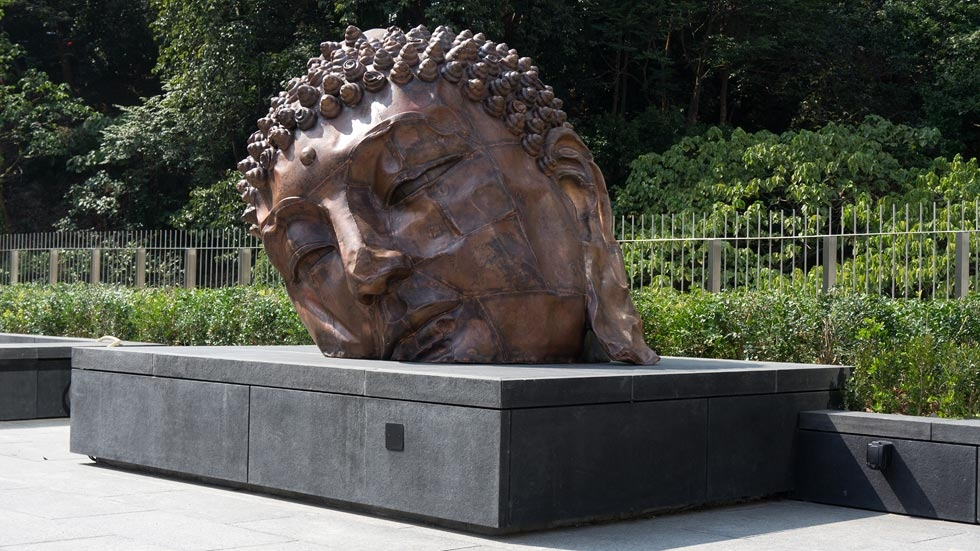 "A Buddha head sculpture by Zhang Huan is part of the Center's ""Transforming Minds: Buddhism in Art"" exhibition. (Asia Society Hong Kong Center)"