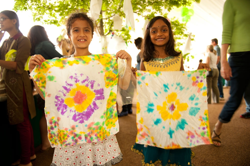 Two young festival-goers wave their newly-dyed shibori cloths (Jeff Fantich).