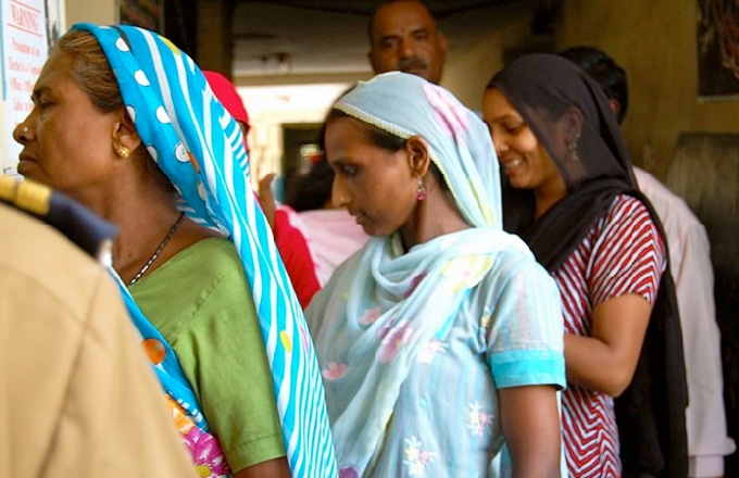 Residents of Dharavi, Mumbai's largest poor neighborhood, lining up to vote in May 2009. (Asia Society India Centre)