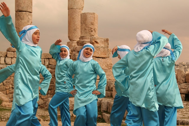 A group of girls dance to celebrate the birth of the prophet Mohammed in Citadeel, Amman, Jordan.  (hazy_jenius/flickr)