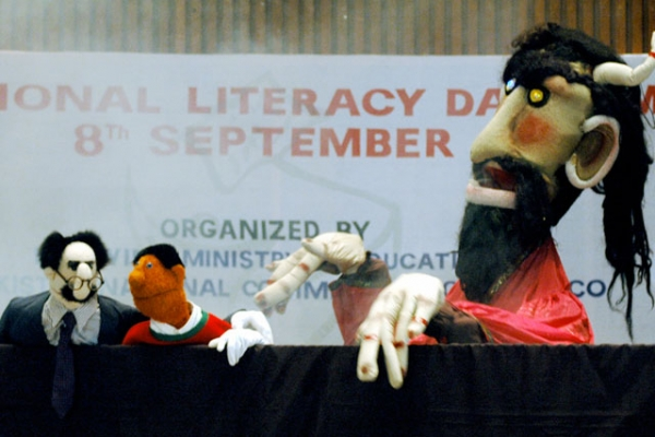 Pakistani puppet participates in literacy event. (Farooq Naeem/Getty Images)