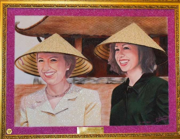 A mosaic portrait of US Secretary of State Hillary Clinton (L) and her daughter Chelsea by Vietnamese artist Dao Trong Cuong