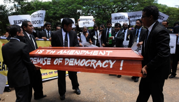 Sri Lankan lawyers carry a makeshift coffin during a protest in Colombo on September 7, 2010 against a draft bill of the constitution that is being rushed through parliament on an urgent basis. (Ishara S. Kodikara/AFP/Getty Images)