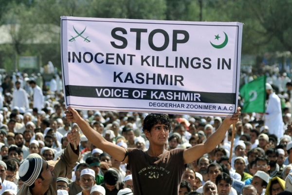 A Kashmiri protester holds a banner during an anti-India rally in Srinagar on September 11, 2010. The Muslim-majority Kashmir valley has been rocked by unrest since a teenage student was killed by a police tear-gas shell on June 11. (Sajjad Hussain/AFP/Getty Images)