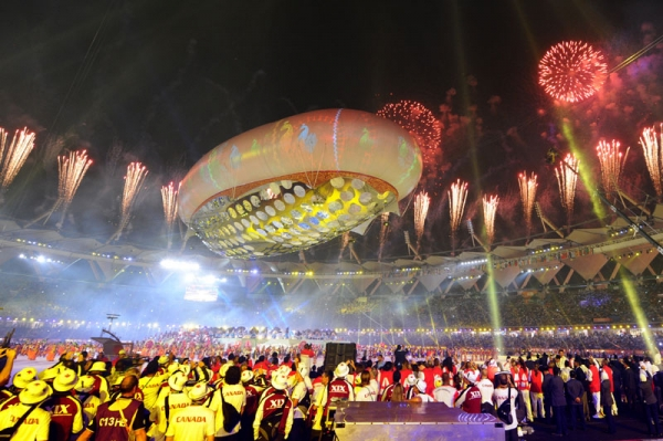 Fireworks light up the sky as performers dance underneath the aerostat during the XIX Commonwealth Games opening ceremony at the Jawaharlal Nehru Stadium in New Delhi on October 3, 2010. (William West/AFP/Getty Images)