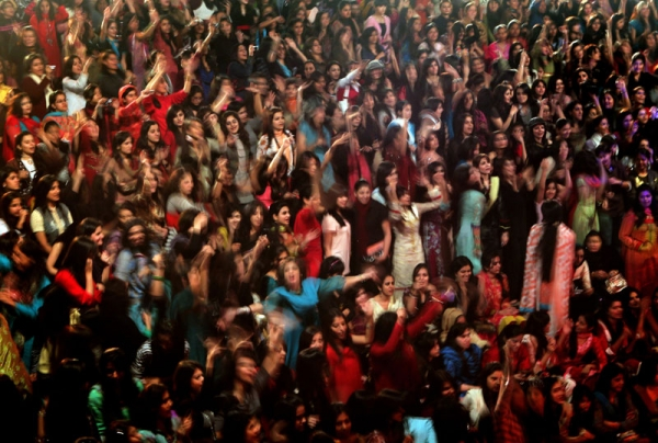 Pakistani female students enjoy the performance of the band Overload during a concert in Kinnaird women's college in Lahore on Feb. 6, 2010. (Behrouz Mehri/AFP/Getty Images)