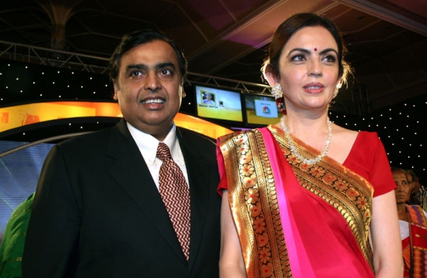 Indian industrialist Mukesh Ambani (L) poses with his wife Neeta Ambani at an awards ceremony in Mumbai on March 10, 2010. (STRDEL/AFP/Getty Images)