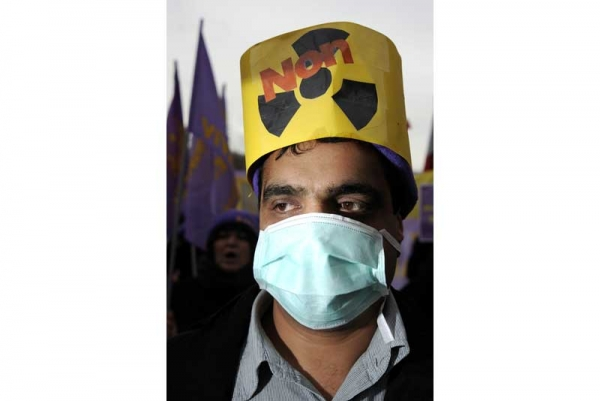 "A member of the Iranian opposition wearing a mask reading ""No to Nuclear"" attends a protest at the ""Place des Nations"" on December 6, 2010 in Geneva. (Fabrice Coffrini/AFP/Getty Images)"