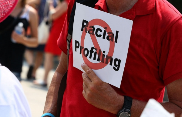 A man holds a sign against racial profiling during a protest with community and faith leaders from Arizona in front of the White House on July 7, 2010 in Washington, DC. (Mark Wilson/Getty Images)