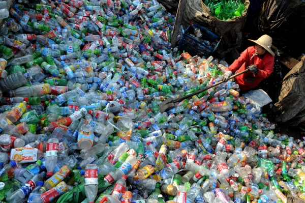 A Chinese worker piles up the plastic bottles collected at a recycling center in Hefei, east China's Anhui province. (STR/AFP/Getty Images)