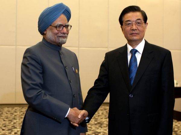 Indian Prime Minister Manmohan Singh (L), is greeted by Chinese president Hu Jintao, on April 13, 2011 in Sanya, Hainan Province, China for the 2011 BRICS Summit. (Nelson Ching/Pool/Getty Images)
