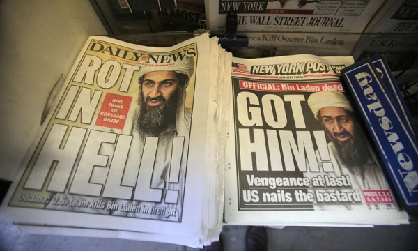 Newspapers announcing the death of accused 9-11 mastermind Osama bin Laden are seen at a newsstand outside the World Trade Center site May 2, 2011 in New York City. (Mario Tama/Getty Images)