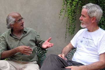 Chris Lydon (R) with Salman Rashid (L) in his walled garden on the south side of Lahore, summer 2011.