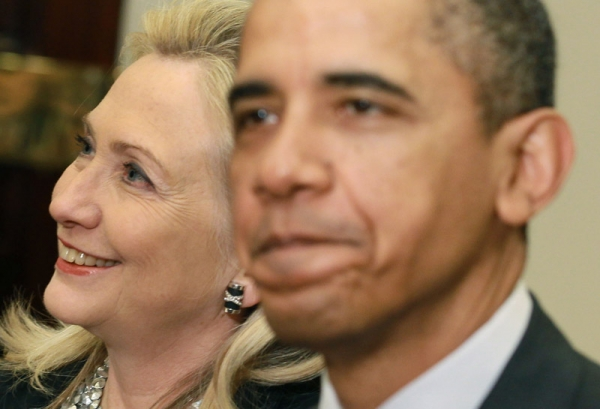 U.S. Secretary of State Hillary Clinton (L), seen here with President Barack Obama in Washington, D.C. on November 28, 2011, makes a historic trip to Burma this week. (Mark Wilson/Getty Images)