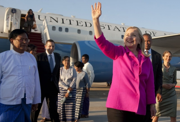 US Secretary of State Hillary Clinton waves alongside Myanmar Deputy Foreign Minister Myo Myint (L) upon her arrival in Naypyidaw on November 30, 2011.(Saul Loeb /AFP/Getty Images)