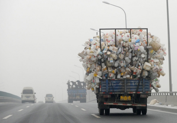 A truck containing used plastic bottles travels along a highway covered in haze in Beijing on December 5, 2011. (Liu Jin/AFP/Getty Images)