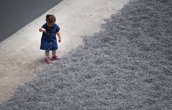 A child plays with some of the seeds in Ai Weiwei's 'Sunflower Seeds' at The Tate Modern in London, England on Oct. 11, 2010. (Peter Macdiarmid/Getty Images)