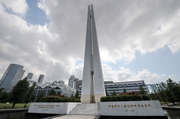 A picture shows the four pillars of the Civilian War Memorial standing 70 metres high in Singapore. The memorial is one of Singapore's most famous landmarks built in memory of civilians killed during the Japanese occupation of Singapore in World War II. (Roslan Rahman/AFP/Getty Images)