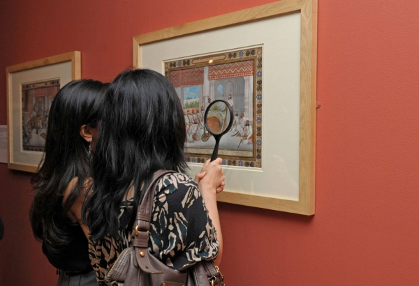 Visitors to Asia Society Museum in New York inspect a piece from the Princes and Painters in Mughal Delhi, 1707 to 1857 exhibition. (Elsa Ruiz/Asia Society)