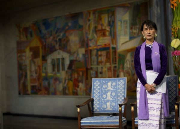 Myanmar democracy icon Aung San Suu Kyi looks on before delivering her Nobel speech during the Nobel ceremony at Oslo's City Hall on June 16, 2012. (Daniel Sannum-Lauten/AFP/Getty Images)