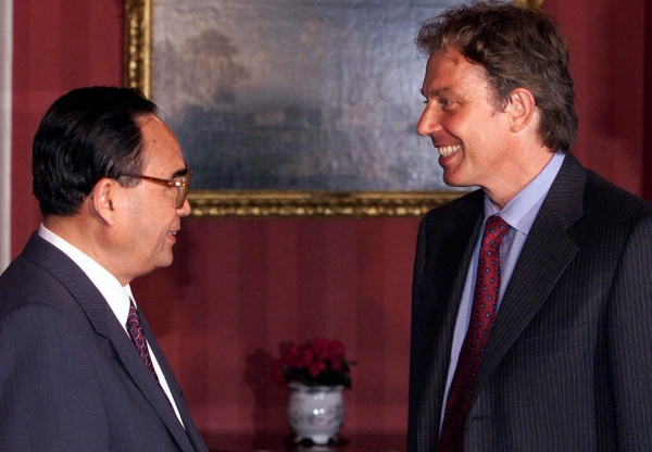 British Prime Minister Tony Blair (R) meets with Chinese Politburo representative Ding Guan'gen at 10 Downing Street on September 6, 1999. Ding passed away on July 22. (Ian Waldie/AFP/Getty Images)